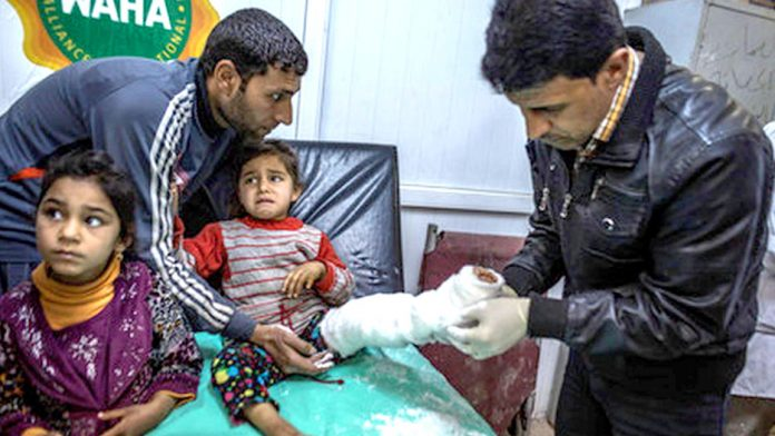 Young girl injured in west Mosul. Photo credit: Amnesty
