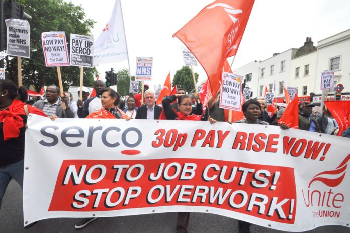 Labour's JOHN McDONNELL behind the banner of the Serco strikers marching through east London on Saturday