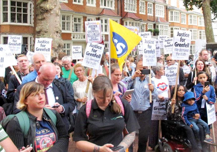 Crowds assemble outside the Kensington Council meeting where Grenfell Tower survivors told the councillors to resign