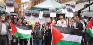 Defiant protesters shouting 'Free Palestine' as they display their national flags
