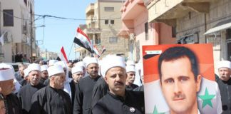 Druze residents of the Golan Heights show their support for Syrian President Assad