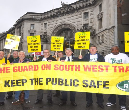 RMT demonstration yesterday morning at Waterloo Station demanding South West Trains keeps their guards on trains in the interest of passenger safety