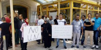 Palestinians demonstrate against the closure on August 11th of the UNRWA hospital in Qalqiliya