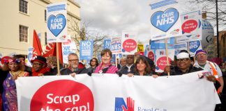 Nurses marching to defend the NHS demanding the 1% pay cap be scrapped