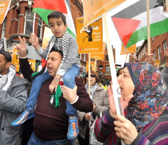 Palestinians outside the Israeli Embassy in London demanding the release of all political prisoners held in Israeli jails