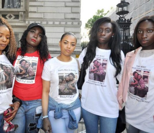 Cousins of Kadija Saye and her mother Mary Mendy, who both died in the Grenfell Tower inferno, on a march to Downing Street