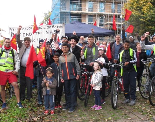Riders and supporters assemble outside Ealing Hospital on Sunday