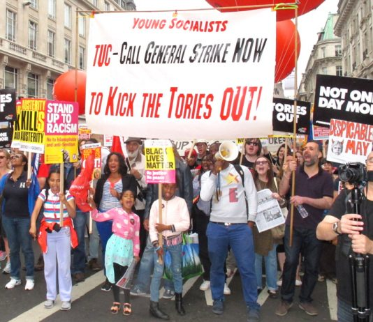 Young Socialists banner on the July 1st march to kick the Tories out demanding the TUC call a general strike