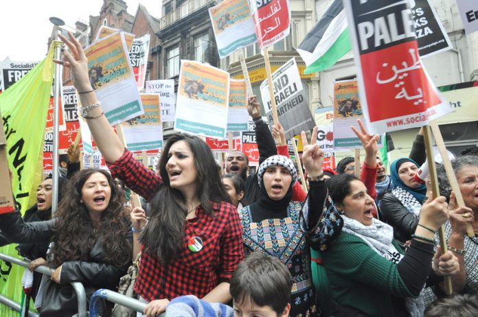 Palestinians demonstrate outside the Israeli embassy against the Israeli bombing of Gaza