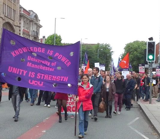 Lecturers, staff and students marching out of the University of Manchester – they are out on strike Monday and Tuesday