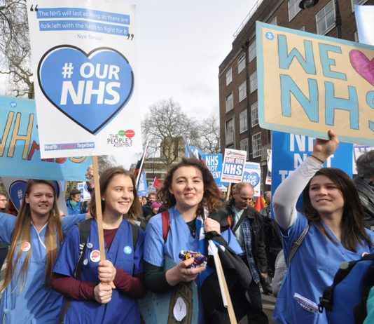 Student nurses marching in defence of the NHS