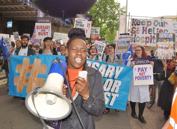 Student nurses and midwives marching to demand that their bursary is restored – axing the bursary has worsened the staffing crisis