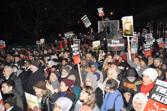 Over 3,000 protesters shouted 'Free Palestine! Hands off Jerusalem!' as they gathered outside the US Embassy in Grosvenor Square on Friday night