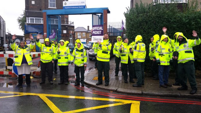 Deptford ambulance workers on the picket line during their nationwide strike in 2014 – they are overworked, understaffed and underpaid