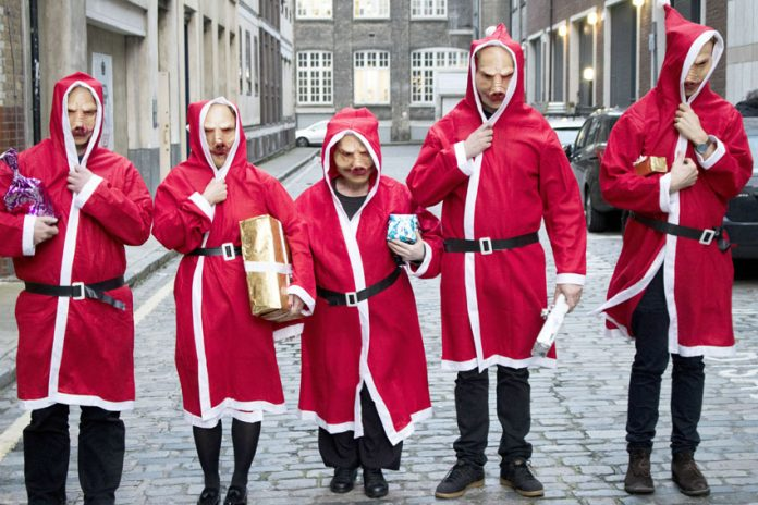 'Christmas Pigs' demonstrated outside four hospitals yesterday lunchtime against private company ISS' 'workhouse' conditions
