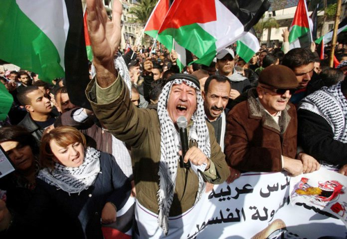 Palestinians marching in Jerusalem against Trump's decision to move the US embassy to Jerusalem