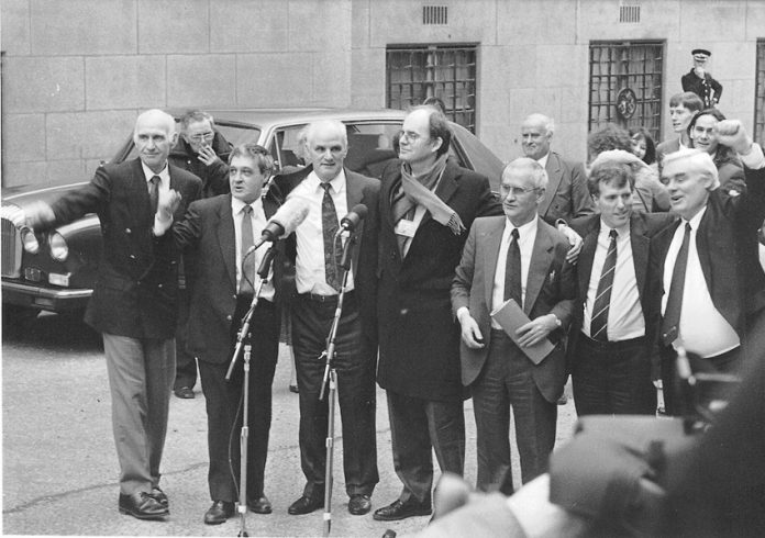 PADDY HILL (second from left) and the Birmingham Six (centre) on the day of their release, March 14, 1991 outside the  Old Bailey, with Labour MP CHRIS MULLIN (centre)
