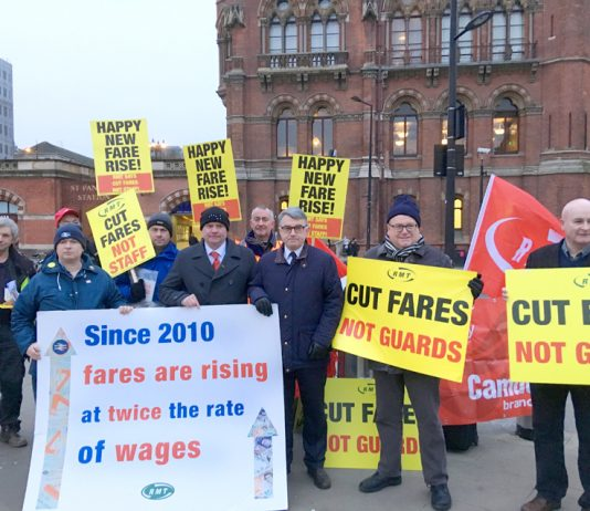 Train staff joined forces with furious commuters demonstrating at stations across the country against massive rail fare hikes which came in yesterday morning – MICK CASH (centre) RMT General Secretary, who joined the King's Cross protest, called for the c