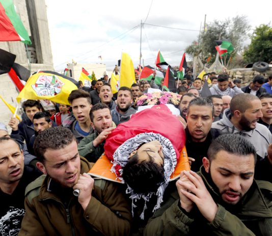 The funeral of Musaab al-Tamimi in the village of Deir Nitham, northwest of the city of Ramallah, to his last resting place. Photo credit: Tamer Bana/WAFA