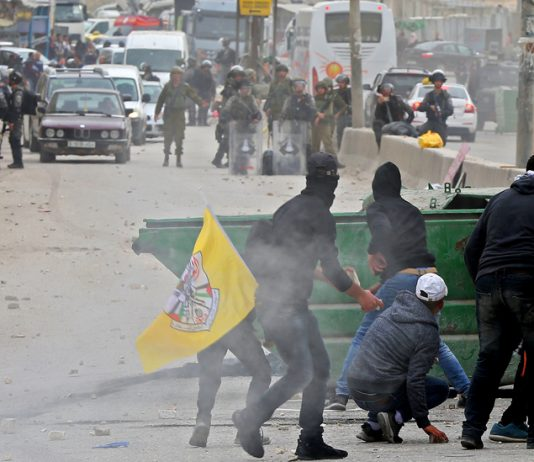 Palestinian youth clash with Israeli forces at the Qalandia checkpoint outside Ramallah