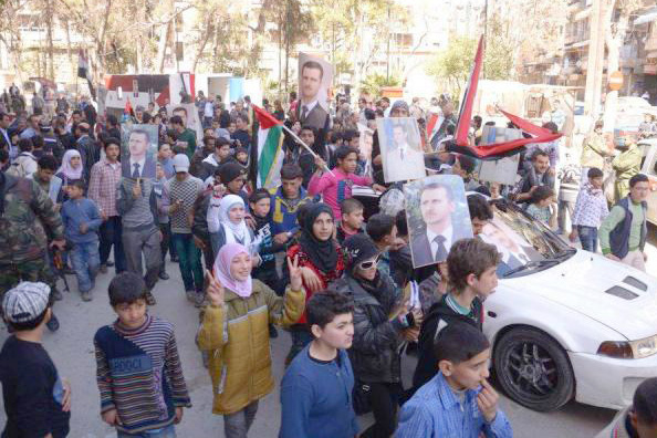 Syrians march in support of President Assad – Syrian Kurds in Afrin are now calling on the Syrian army to defend them