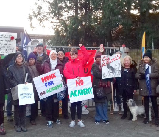 Teachers were joined by parents outside The Village School in Kingsbury, north west London, on their picket line yesterday morning