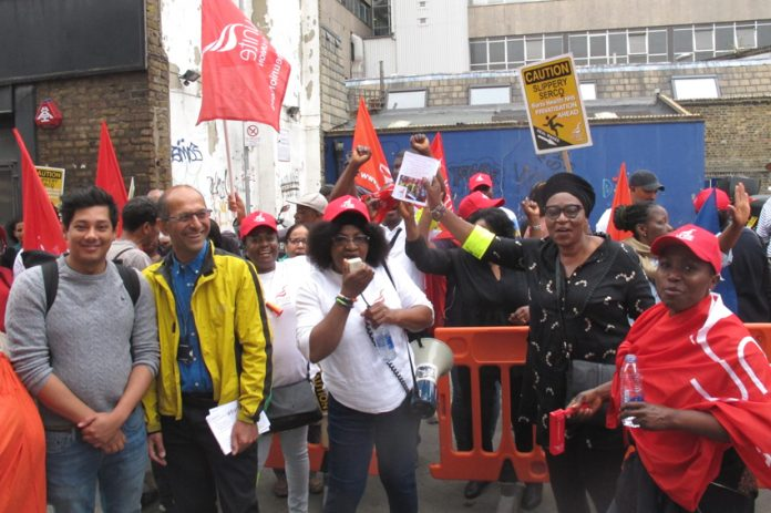 Cleaners and caterg staff in the NHS working for Serco at the London Hospital taking strike action last year against excessive workload and pay cuts