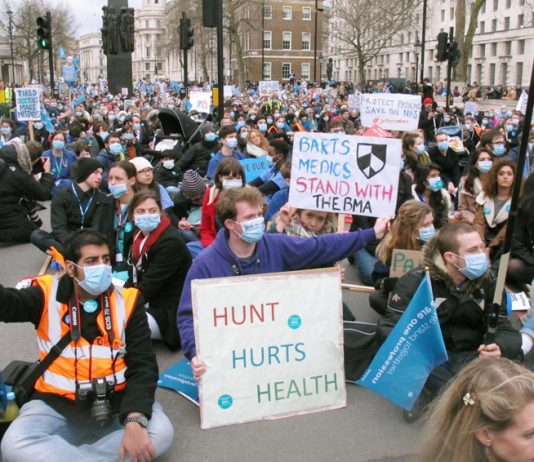 Junior doctors block Whitehall during their strike – doctors oppose NHS England's new dangerous 'Stay Well Pharmacy' campaign