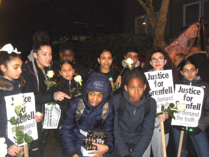 Youth on December's silent march for Grenfell in North Kensington, London – they demand Justice for Grenfell