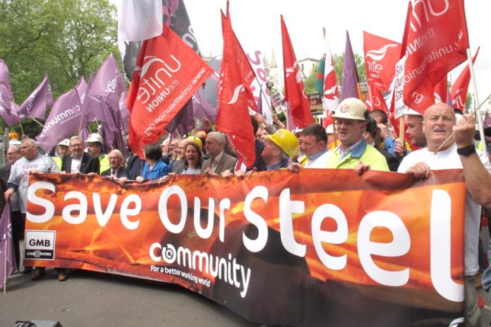 Labour leader Corbyn marching with steelworkers in defence of their jobs