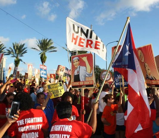 Unite Here Disney workers demonstrate in central Florida on Monday against the company withholding their $1,000 bonuses