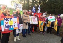 Striking NEU members on the picket line at The Village School in Kingsbury yesterday morning