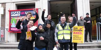 Picket at the School of Oriental and African Studies (above right) in central London show their determination to defend their pensions