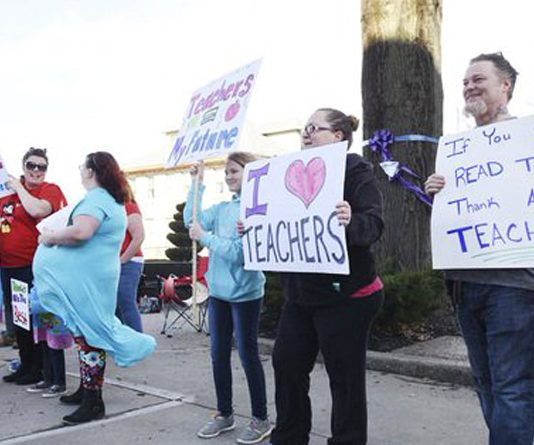 Raleigh County teachers and supporters picket at Shoemaker Square in Beckley during the first day of the statewide teachers' walk-out