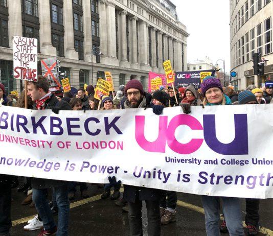 Thousands of lecturers marched through central London yesterday, the fifth day of their strike in defence of pensions