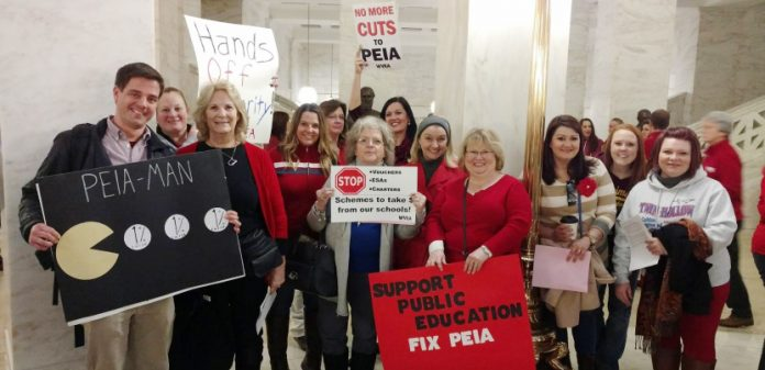 Striking West Virginia teachers show their concern over the high rates they will have to pay to cover their health insurance