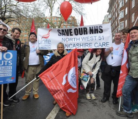 Unite members with their banner on the 'Save Our NHS' march against privatisation
