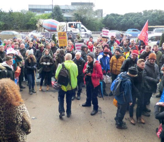 Striking lecturers and masses of students were addressed yesterday by Chris Townsend representing the student occupation