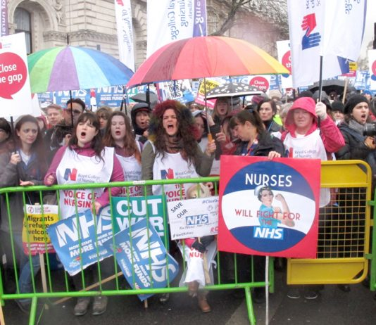 Nurses rally outside Downing Street demanding an end to cuts and for kicking privateers out of the NHS