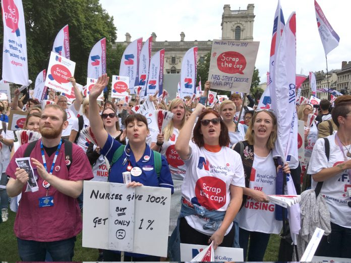 Nurses rally in Parliament Square demanding that the pay cap be smashed