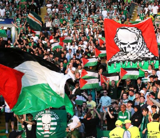 Fans of Scottish team Celtic raise Palestinian flags during a game against Israeli team Hapoel Beersheba last year