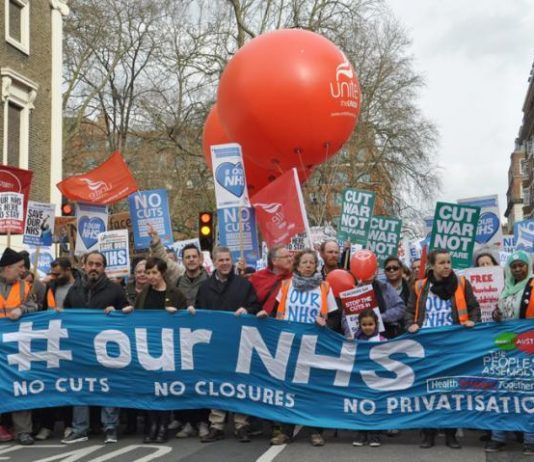 Health workers marching to defend the NHS, demanding no cuts, no closures and no privatisation