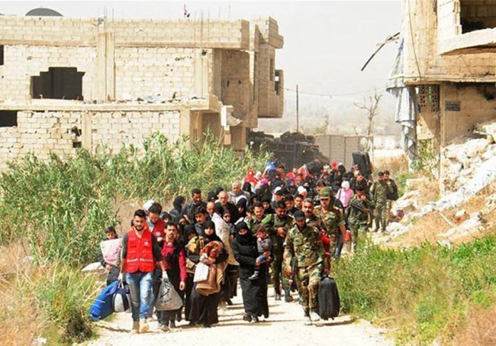 Syrians leave Eastern Ghouta after it was liberated from the terrorists by the Syrian army and its allies