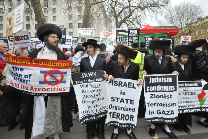 Orthodox Jews, joining the rally on Saturday against the Israeli killings in Gaza, condemn Zionist terrorism