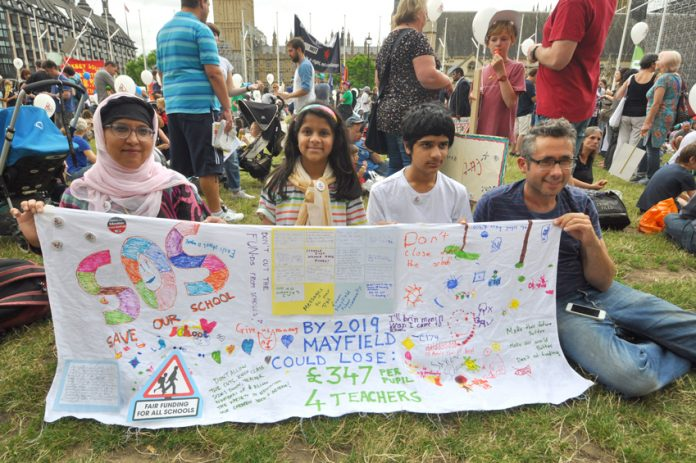 Parents and pupils protest against cuts in funding and loss of teachers