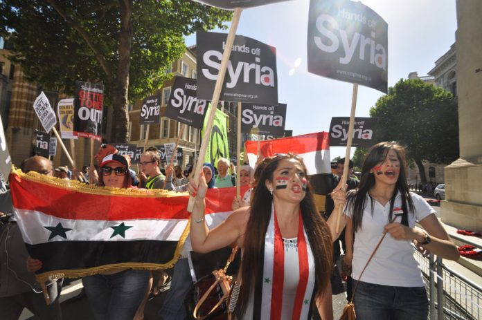 Thousands took to the streets the last time the Tories tried to take Britain to war against Syria in 2013 – then ex-PM Cameron was defeated in Parliament. PM May however recalled her Cabinet in an attempt to join the US war effort without a parliamentary