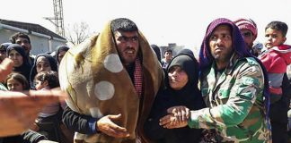 Syrians leave Eastern Ghouta after it was liberated by the Syrian army
