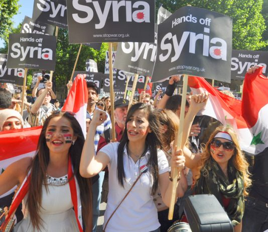 Hands off Syria' demonstration in London in 2013 when former PM Cameron's vote for bombing was defeated in Parliament – PM May has bypassed Parliament to authorise military action