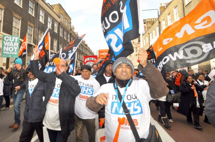 GMB members marching in defence of the NHS – the union is recommending a rejection of the pay offer