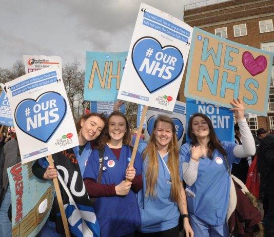 Nurses on the 'Our NHS' demonstration in central London – in Manchester health and council workers are striking against the merger of their services
